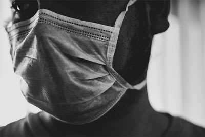 person wearing a face mask as protection against covid-19